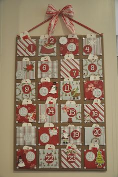 cover cork board with material. Handmade advent calendar; fill pockets with nightly activities for family instead of gifts