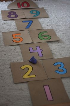 Make an easy, indoor hopscotch for rainy day fun. Cardboard, acrylic paints and a beanbag are all you need to make this indoor activity for kids. Preschool Movement Activities, Educational Activities For Preschoolers, Sports Activities For Kids, Toddler Learning Activities, Indoor Activities For Kids, Montessori Activities, Preschool Decor, Preschool Activities, Time Kids