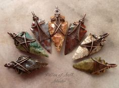 NEW: Arrowhead pendants! Each stone arrowhead is different. Wire wrapped with copper.