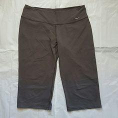Nike Dri-Fit Gray Capris Nike brand. Womens Size Large. (12-14) Dark gray color.  Dri-Fit capris/cropped pants. Great condition- the inside label is peeling off a bit.  Super comfortable! Nike Pants Capris