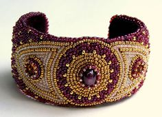 Raspberry coloured Bead Embroidered Cuff for July with 3 carat Star Ruby cabochon in centre