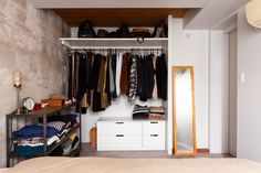 ベッドルームは戸境壁を躯体現しで。あたたかみがあるカーペットといいコントラスト。クローゼットはオープンで奥行きを出しました。   #K様邸氷川台 #寝室 #ベッドルーム #bedroom #bedroointerier #オープンラック #ベッド #クローゼット #扉なし #ikea収納 #EcoDeco #エコデコ #リノベーション #renovation Storage, Amazing, Interior, Room, Closet, Furniture, Home Decor, Purse Storage, Bedroom