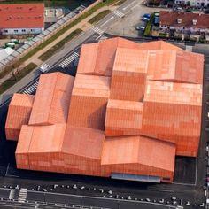Manuelle+Gautrand+divides+exhibition+centre+into+13+orange-hued+blocks