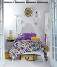 Land of Nod Catalog.  Great styling.  Love the art, white background, luggage under bed.