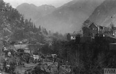 An Austro-Hungarian transport column passing one of the Italian villages in the mountains, November 1917.  THE BATTLE OF CAPORETTO, OCTOBER-NOVEMBER 1917