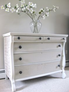 White Painted Dressers With 5 Drawer And There Are Flower Pot