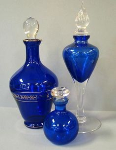 Cobalt Blue Decanter and perfume bottle. The tallest piece is 10 clear stoppers, Blue Perfume, Antique Perfume Bottles, Vintage Bottles, Cobalt Glass, Cobalt Blue, Im Blue, Blue And White, Glas Art, Beautiful Perfume