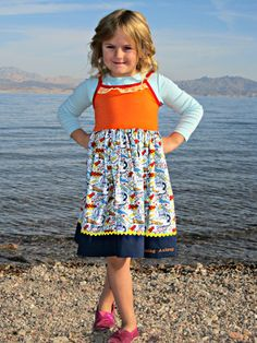 Super hero PARTY DRESS:  Riley Blake superhero fabric in blue, with navy trim, ric-rac and lace.  Tank dress, knit bodice