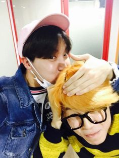But why does J-Hope look like a little boy giving his grandmother a kissie
