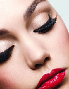 Dramatic cat eyes with red lips are effortlessly paired with a new dress this holiday. -- Be sure to check out this helpful article.