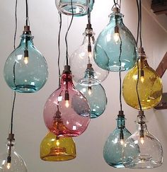 B-e-a-utiful handblown glass pendant lights. I adore blown glass. These lights are colorful with a vintage feel.