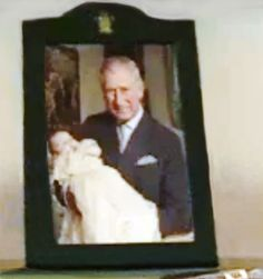 Prince Charles with Prince George at his christening.  This photo was taken off a live webchat for one of Prince Charles charities - the only time it has ever been seen by the public.