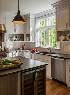 Open shelves under cabinets bring character to a kitchen while offering a cottage feel displaying colorful kitchenware.