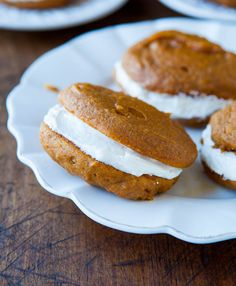Pumpkin Whoopie Pies with Vanilla Buttercream Filling - Super soft pumpkin cookies with enough spice to stand up to that sweet fluffy filling! Easy recipe at averiecooks.com - even if you've never made whoopie pies, these are simple!