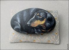 -Dachshund hand painted rock by Alika-Rikki, via Flickr...more amazing rock paintings...on the site.