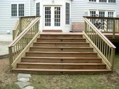 Deck Steps with Landing | These deck stairs have lights in the middle of every other step.