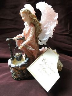 Boyd's Collection CHARMING ANGELS  Julianna Guardian of Wishes Figurine 2002 • Limited Edition January to December 2002. This angel is marked February 2398, Style No. 28225 Condition: Very Good. It has no markings, no cracks, and no chips. Sorry box is not included.