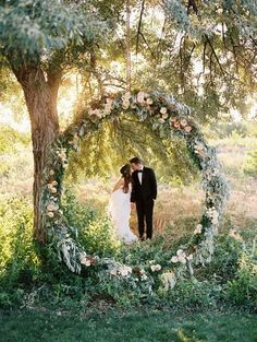 A beautiful floral wreath like this one could double as both an arbour and a photo op station for your guests.