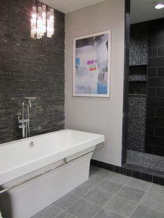 No door to shower, raised floor, recessed lighting, built in shelving, mixed tile
