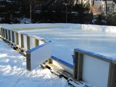 Backyard ice rink with entry gate