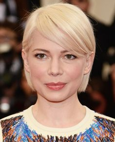 If longer strands seem impractical come summer, consider a chin-length cut with sweeping fringe. Michelle Williams' gracefully grown crop, for example, is both timeless and manageable for the sweltering days ahead.