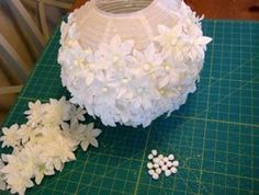 Lamp with paper flowers. Cool idea with a ton of potential for other additions.