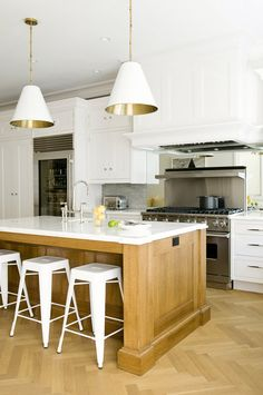 Love this kitchen featuring the Goodman Hanging Lamps by Thomas O'Brien | TOB5091