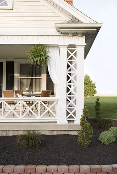 Covered Front Porch with Ferns and Landscaping