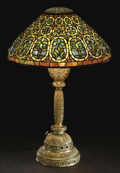 "TIFFANY STUDIOS  ""VENETIAN"" TABLE LAMP    shade impressed TIFFANY STUDIOS NEW YORK 517  base impressed TIFFANY STUDIOS/NEW YORK/515    leaded glass and patinated bronze  19 3/4 in. (50.2 cm) high  31 1/4 in. (79.4 cm) diameter of shade  circa 1910"