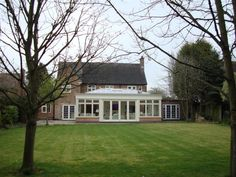 One of our timber orangeries with bifold sliding doors and a bespoke roof lantern all designed and built in the UK