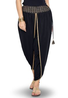 Best 12 Black cotton dhoti pant detailed with foil printed waist band in geometrical motif Enhance with pleats and contrast piping – SkillOfKing. Salwar Designs, Kurti Neck Designs, Blouse Designs, Trajes Pakistani, Pakistani Dresses, Dress Indian Style, Indian Outfits, Fashion Pants, Fashion Dresses