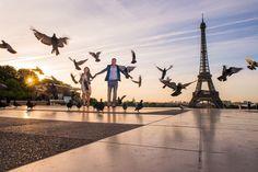 Love this action shot. Photographer Paris sunrise photo couple chasing pigeons Trocadero Paris Eiffel Tower