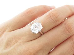 3 carat Oval Diamond Anniversary Engagement 8 Prong Ring, Size 5, 6, 7, 8, Man Made Diamond, Wedding ring, Birthstone, Sterling Silver on Etsy, $79.99 (this one)