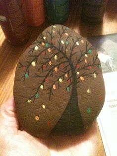 "Fall tree painted rock I made. My 3 year old calls this one mommys ""brownie christmas tree"" rock!"