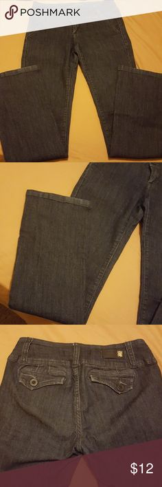 Dressy jeans Cute dark  blue denim jeans. Makes your butt look great with the pockets. Still lots if life left. Love Culture Jeans