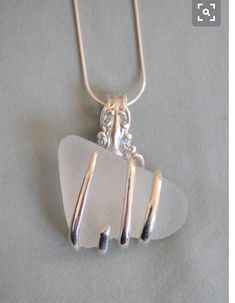 Use old silver fork to hold sea glass