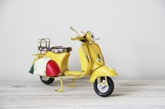 Yellow Vespa bike, vintage, collectible, retro miniature, tin and rubber, yellow Vespa scooter with Italian flag colours, early nineties