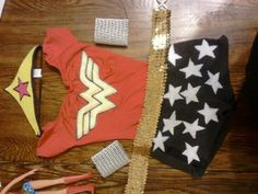 Homemade wonder woman costume made with my 5 yr old..used old red leotard, blue shorts, the stars, emblem made with white felt, markers and glue, crown also made with felt but bought at Target on clearance for 80 cents, wrist bands are asian pear holder sprayed painted silver and the sequence belt was older sisters..now she is ready for halloween or saving the day.