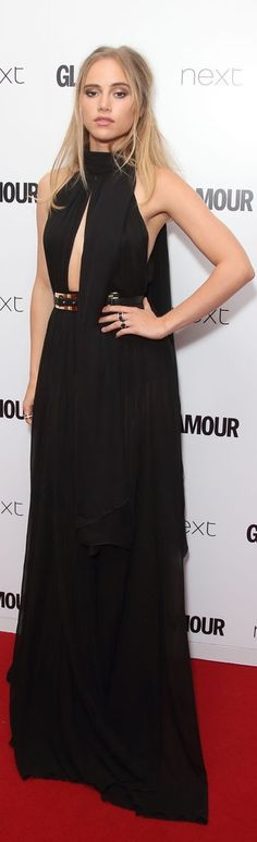 Suki Waterhouse rocked a black gothic-inspired gown that boasted a high neck and a single cutout. She played up the edge with her hardware: a thick belt and a handful of chunky rings at the Glamour Awards.