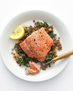 Wild Salmon with Lentils and Arugula - Vitamin D-rich foods, like salmon, tuna, egg yolks, and fortified dairy, play a key role in beating the winter blues.