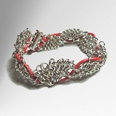 This lesson shows how to develop chain mail bracelet in a zigzag fan shape.  I show you how to embellish the finished work in order to add an extra color.  Let's start!