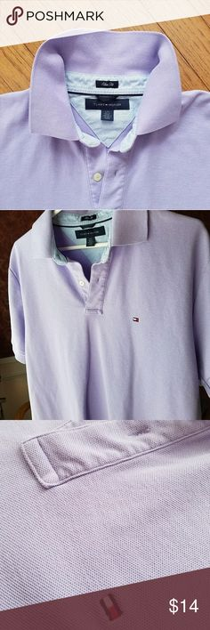 Men's Tommy Hilfiger polo shirt Men's Tommy Hilfiger slim fit polo shirt. 100% cotton, 2-button placket, side vents, Tommy flag embroidered at chest, ribbed trim, lavender, size large in excellent used condition. Runs slightly small, see measurements in photos. Some photos make the shirt look blue, but it is truly lavender in color. No stains or signs of wear. Smoke free home, EUC. Tommy Hilfiger Shirts Polos