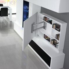 Salón Comedor con Mueble TV Blanco. Detalle Ambiente 1912 - Colección ONA - Baixmoduls. Paneles TV blanco con estanteria . Giratorio, para televisiones de gran tamaño.