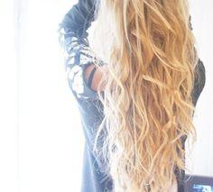 Section hair into 5-10 big sections then braid each in a loose braid. Run a flatiron over each braid, let them cool down, spray hairspray and undo the braids.