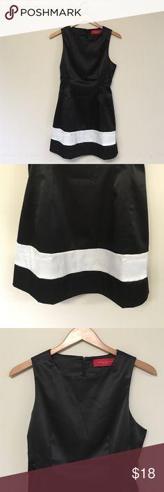 AKIRA black dress AKIRA great condition black dress with white stripe on the bottom AKIRA Dresses Mini