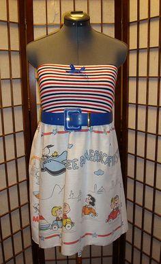 Cute repurposing of old Peanuts sheets? curtains?