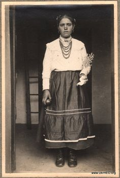 Photograph of a woman in the Podillia region of Ukraine, probably 1910s or 1920s.