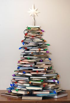 Very Merry Vintage Style: How to Make a Christmas Tree with Books (I so need to do this with all the books I have!)