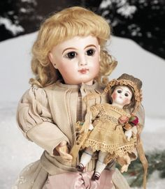 """16"""" French Bisque Bebe Jumeau~~~MARKS: Depose E 7 J (head) Jumeau Medaille d'Or Paris (body). COMMENTS: Emile Jumeau, circa 1885. VALUE POINTS: Beautiful doll with fine quality bisque, rich eyes, original signed body, antique costume.~~~~6""""MARKS: 130. COMMENTS: Kestner, circa 1915. VALUE POINTS: Pretty wide-eyed all bisque has rosy cheeks, antique costume, original body parts."""