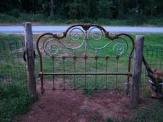 Upcycled headboard into a garden gate